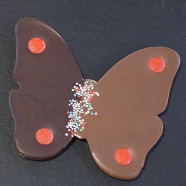 Schmetterling mit Nonpareille mit Zartbitter und Edelvollmilch Schokolade